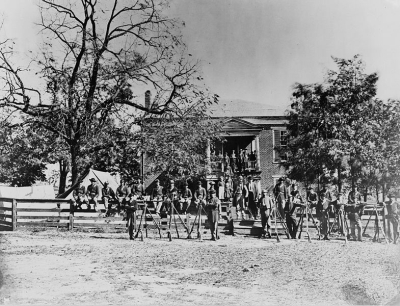 Union soldiers pose in front of Appomattox Court House following Lee's surrender.